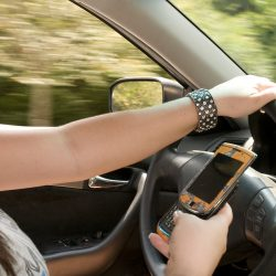 15866-a-teen-girl-texting-while-driving-pv